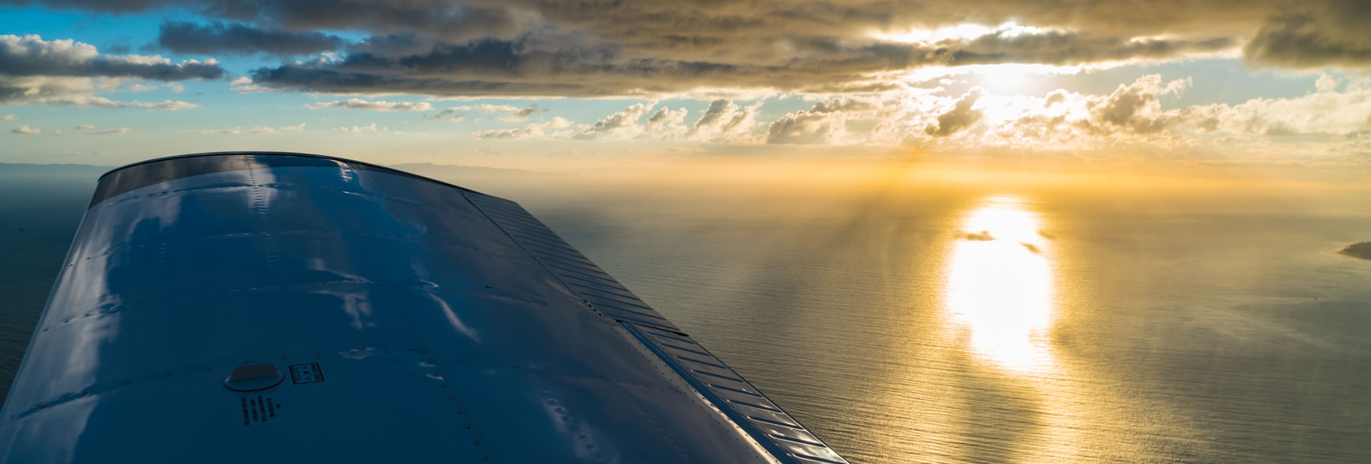 Flying over ocean at Sunset